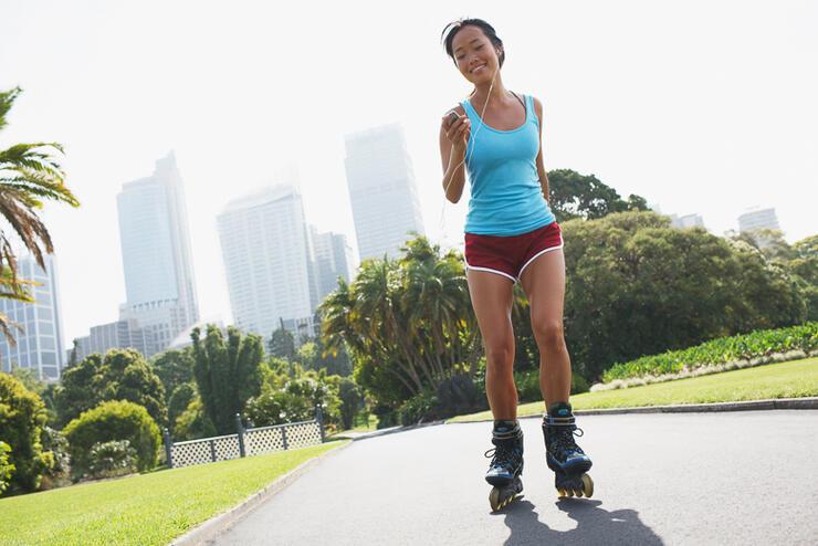 Woman rollerblading in urban park