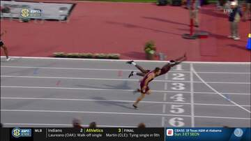 Whiskey and Randy - College Runner Dives Across the Finish Line to Win a Race