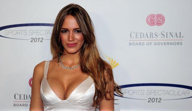Model Shannon de Lima poses on arrival f