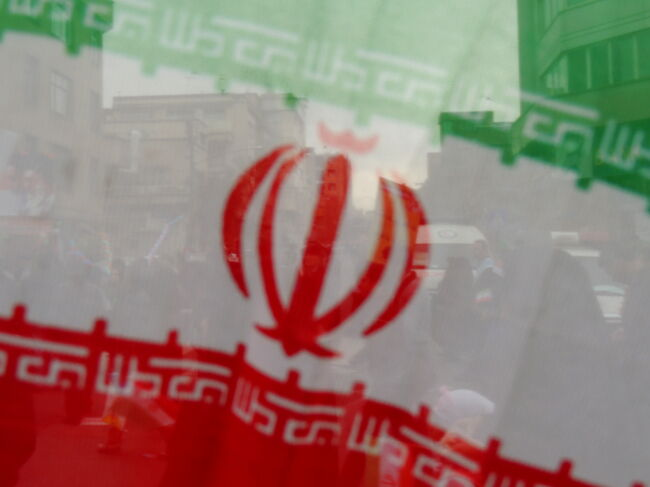 Iran flag oblique and people behind - Tehran