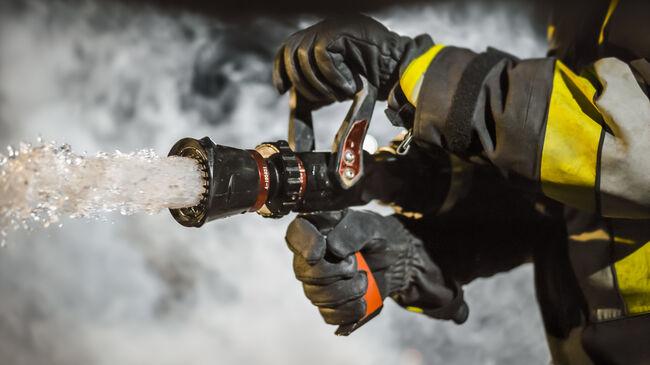 Firefighter using extinguisher