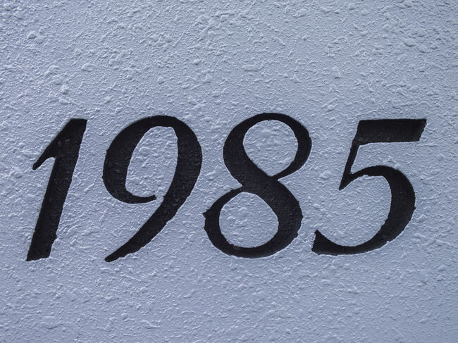 1985s imageCreated number on white wall