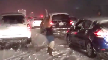 Mollie Kendrick - Woman Celebrates May Snowstorm By Gettin' Down During Traffic Jam