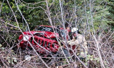 Weird News - Woman Spots Jeep Dangling Over A Ravine With Driver Trapped Inside