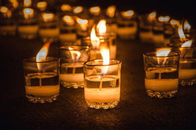 Close-Up Of Burning Tea Lights