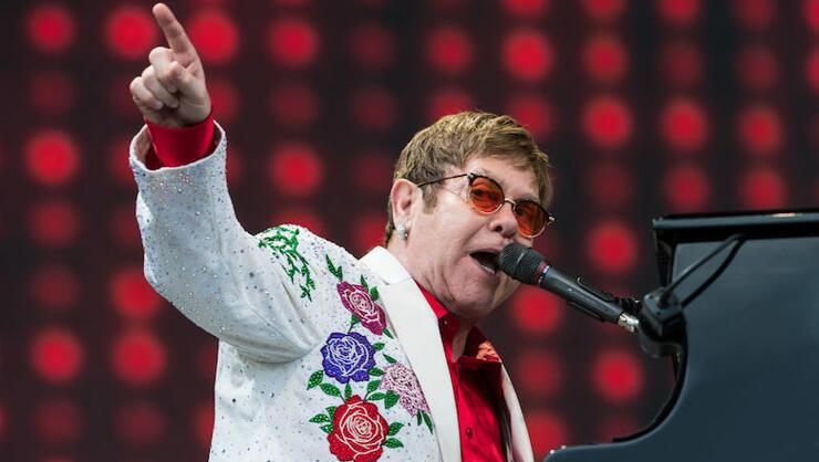 Elton John Defends Ellen Degeneres' Friendship With George W. Bush | iHeartRadio