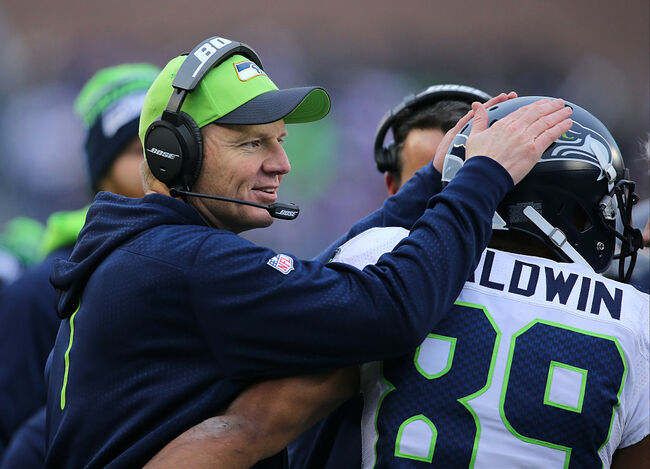 Getty - - Darrell Bevell with Doug Baldwin in Seattle