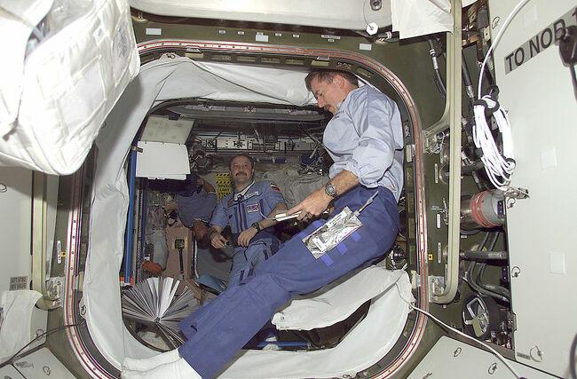 Shuttle Crew Installs Quest Airlock