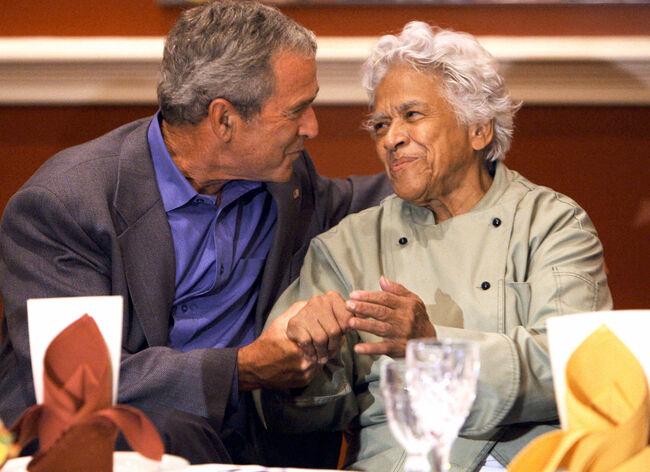 US President George W. Bush holds the ha