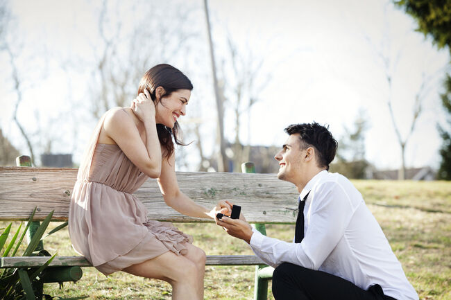Man proposing to girlfriend at park