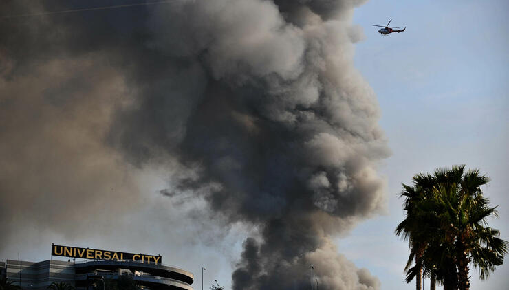 Smoke rises over burning structures at U