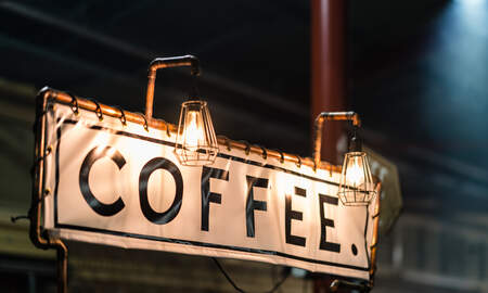 Weird News - Can You Spot The Bizarre Optical Illusion This Coffee Sign Makes?