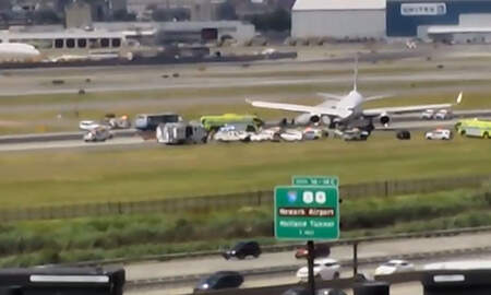 National News - United Airlines Plane Skids Off The Runway At Newark Airport
