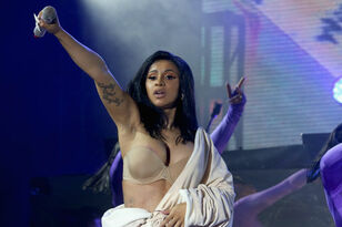 Cardi B Forced To Wear Bathrobe After Wardrobe Malfunction At Bonnaroo