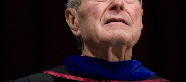 Former President George H.W. Bush listen