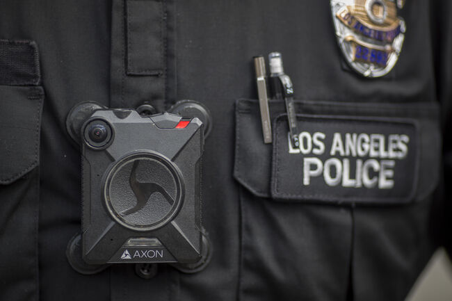 FEBRUARY 18: A Los Angeles police officer wear an AXON body camera during the Immigrants Make America Great March to protest actions being taken by the Trump administration on February 18, 2017 in Los Angeles, California. Protesters are calling for an end to stepped up ICE raids and deportations, and that health care be provided for documented and undocumented people. (Photo by David McNew/Getty Images)