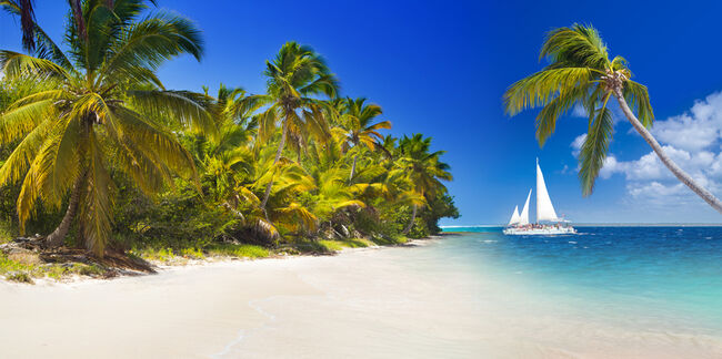 Tropical beach and sailing boat