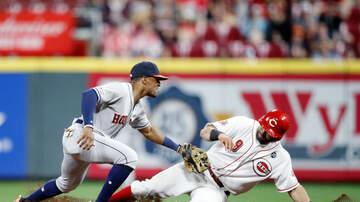 Sports Desk - Reds Edge Astros 3-2