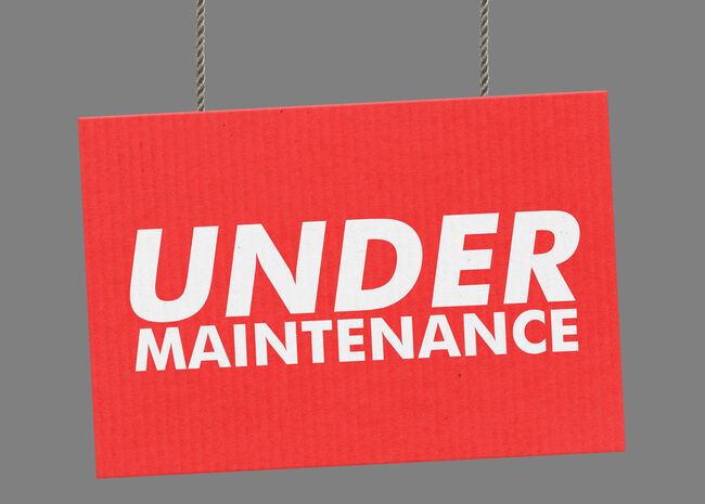 Under maintenance sign hanging from ropes. Clipping path included so you can put your own background.
