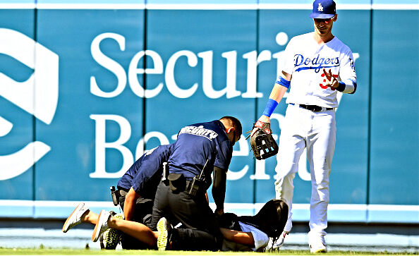 Another female fan interrupted a game by running on the field in attempt to hug Dodgers star Cody Bellinger.