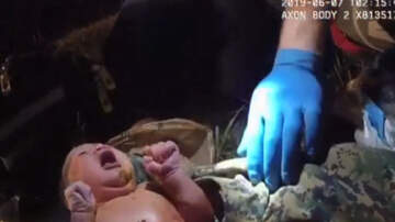 National News - Video Shows Officer Rescuing Newborn Baby From Plastic Bag