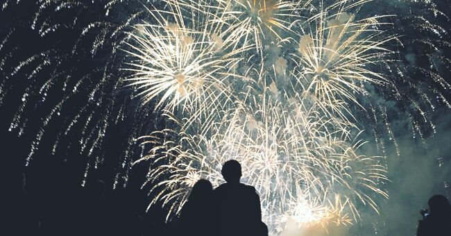 Rear View Of Silhouette Couple Looking At Firework Display At Night- Credit: Stanley Csovari / EyeEm