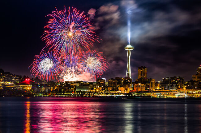 Lake Union 4th of July Fireworks and the Seattle skyline, as seen from across Elliott Bay at Seacrest Park in West Seattle, WA, USA