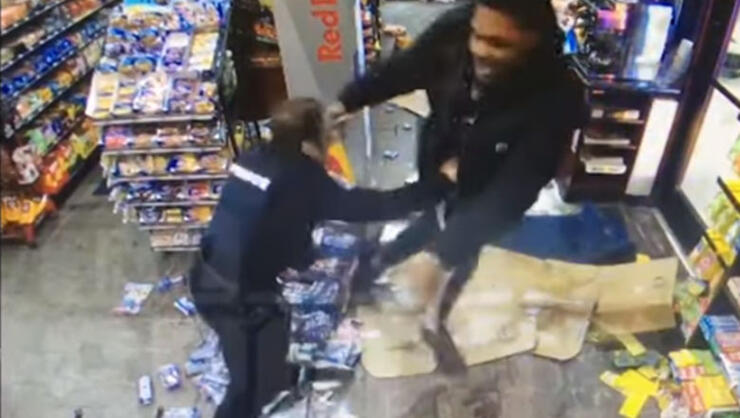 Malik McDowell and a police officer fighting inside a convenience store