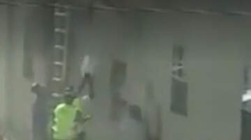 National News - Dramatic Video Shows Roofer Catching Kids Dropped From Burning Building