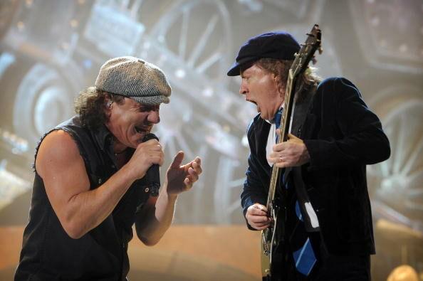 British singer Brian Johnson (L) and gui