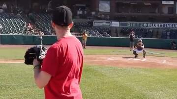 Lee Valsvik - Military Mom throws out 1st pitch at a ballgame....the catcher, her son!