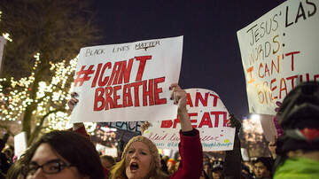 National News - DOJ Refuses to Charge NYPD Officer Involved in Death of Eric Garner