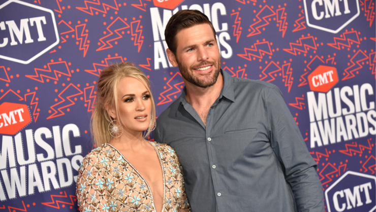 Carrie Underwood And Mike Fisher Take Part In The Viral FaceApp Challenge  | iHeartRadio