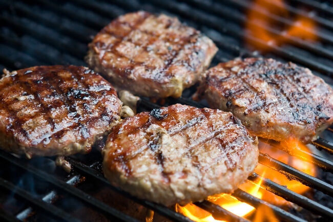 Hamburgers on the grill-getty images