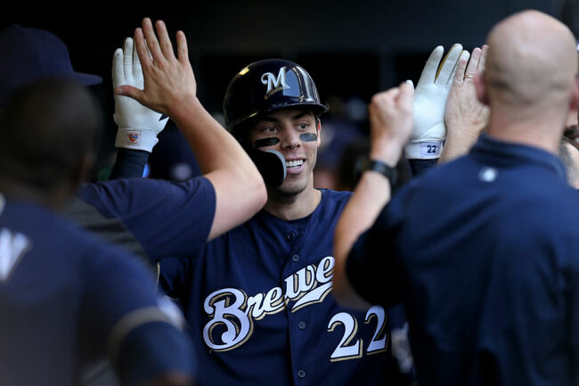 Brewers hang on to win 5-4 over Braves