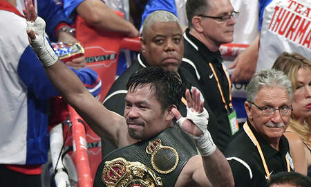 National News - Manny Pacquiao Hands Keith Thurman His First Career Loss By Split Decision