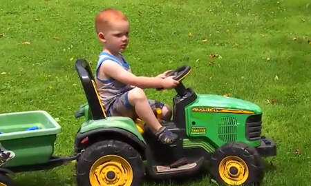 Weird News - Toddler Drives His Battery-Powered Toy Tractor To County Fair