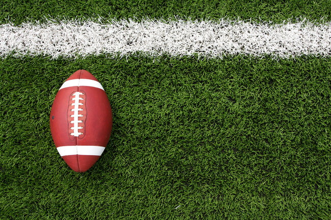 Overhead view of a football lying on a football field