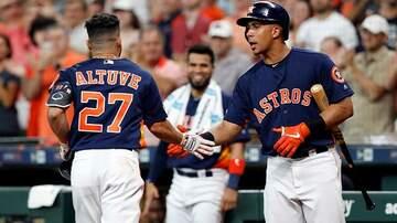 Sports Desk - Astros sweep Rangers