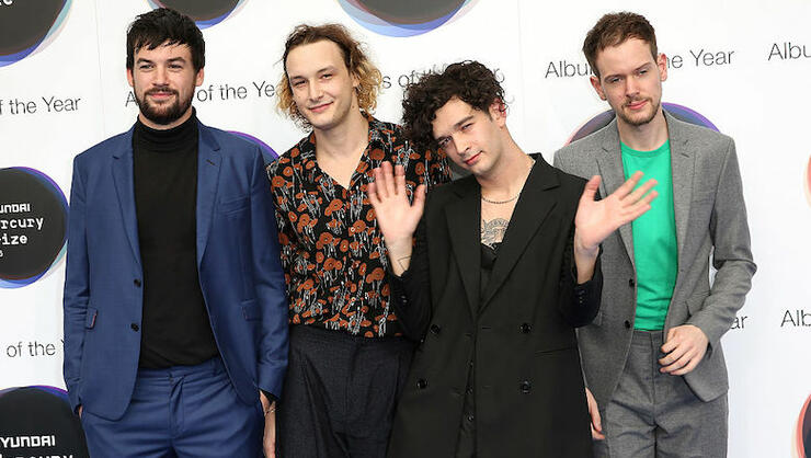 The 1975 Dabble In Sustainable Fashion By Repurposing Old T-Shirts | iHeartRadio