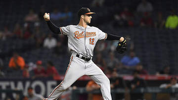 Sports Top Stories - Orioles' Stevie Wilkerson Becomes First Position Player To Earn A Save