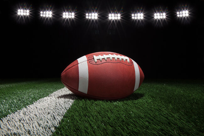 Close-Up Of American Football On Football Field