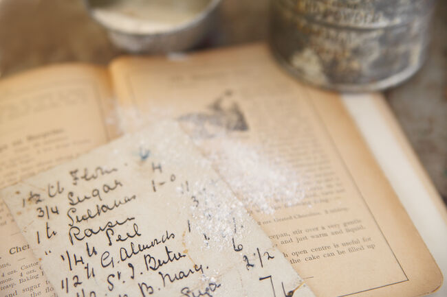 vintage cookbook with handwritten recipe