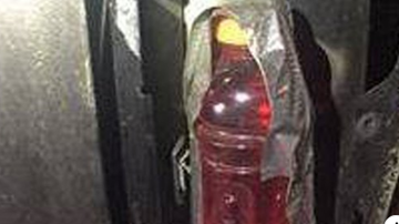 Qui West - Man Allegedly Tried To Replace Busted Tail Light With Red Sports Drink!