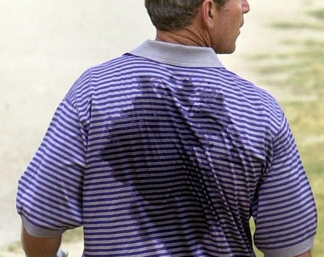 US President George W. Bush, his shirt drenched in