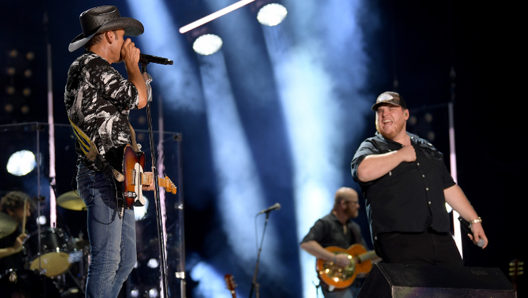 Tim McGraw And Luke Combs Light Up Nashville With 'Real Good Man' Duet | iHeartRadio