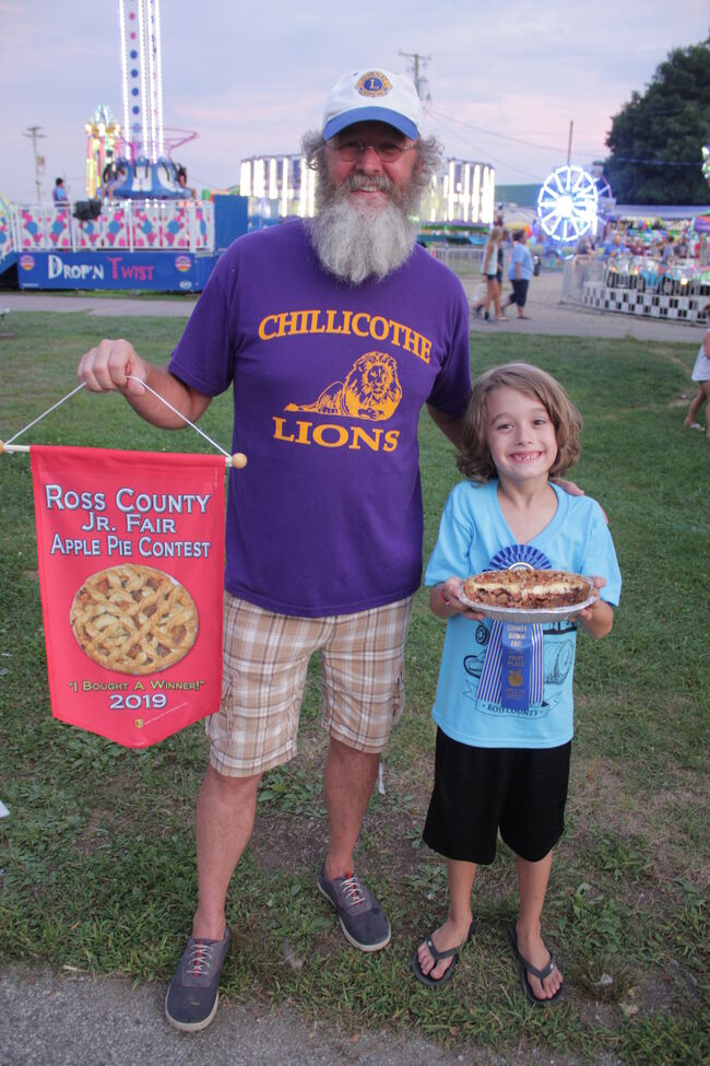 Joe Sharp with blue-ribbon pie and its assistant baker Brody