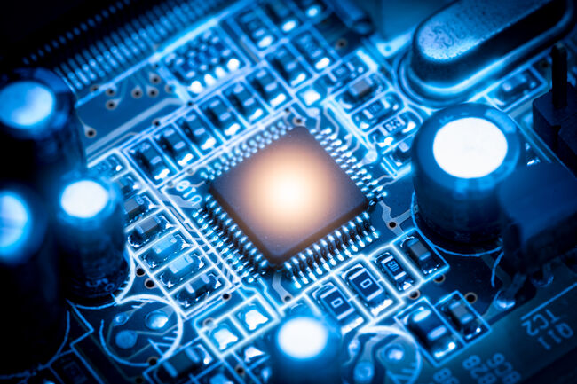 The abstract image of the chipset illumination on the computer mainboard. The concept of computer, hardware, futuristic, electronics and technology.