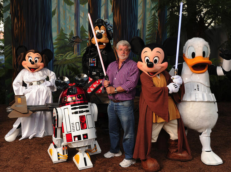 "George Lucas Poses With A Group Of ""Star Wars"" Inspired Disney Characters At Disney's Hollywood Studios"