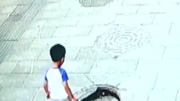 Travis - Little Kid Sees That A Manhole Cover Is Broken But Tests His Luck Anyway
